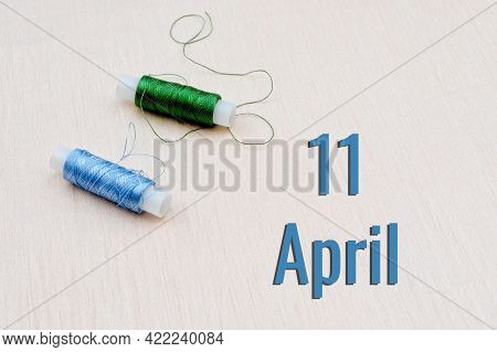 Handicraft Calendar 11 April. Skeins Of Green And Blue Threads For Embroidery On A Beige Background.