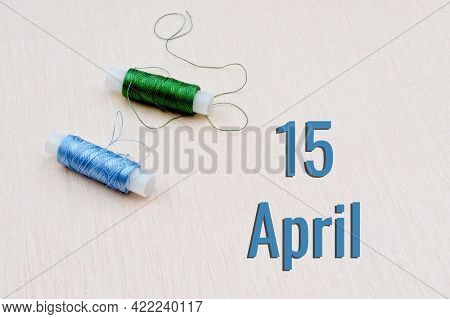 Handicraft Calendar 15 April. Skeins Of Green And Blue Threads For Embroidery On A Beige Background.
