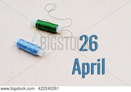 Handicraft Calendar 26 April. Skeins Of Green And Blue Threads For Embroidery On A Beige Background.