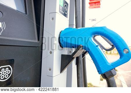 Types Of Ev Chargers In Ev Charger Station In Focus. Ac Ev Charger. Fast Charger Of Ev In Station. A