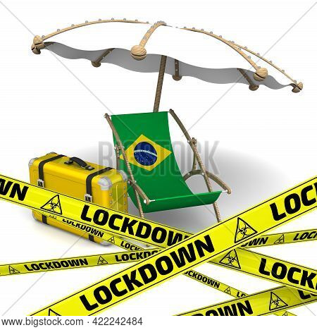 Tourist Lockdown In Brazil. Empty Sunbed With A Flag Of Brazil, An Umbrella And A Retro Suitcase On