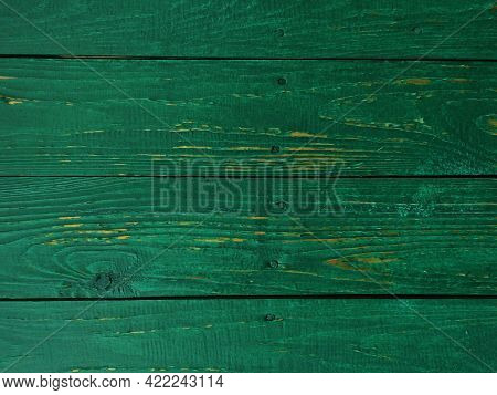 Background Texture Of Wooden Boards Covered With Green Paint. The Surface Of The Wood Texture Is Cov