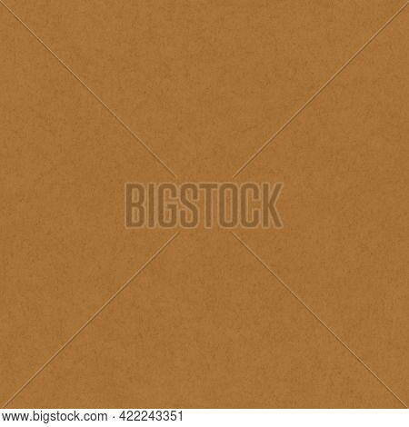 Brown paper cardboard or paper texture showing close up of fibers and material. Empty blank brown background. Seamless tiled texture.