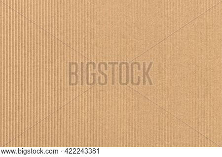 Corrugated cardboard texture. Blank empty cardboard with ridges. Recycled material background.
