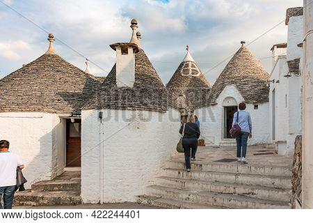Alberobello, Italy - June 30, 2014: Tourists Visiting The Trulli Village In Alberobello, Italy.