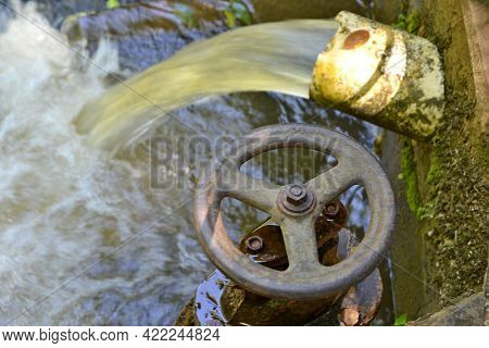 Polluted Water. Polluted Water Coming Out Of A Pvc Pipe With A Record Of Opening And Closing In A Po