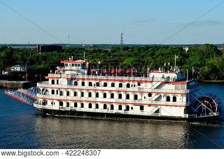 Tourist On Riverboat Cruising Along The Savannah, Georgia River Background.
