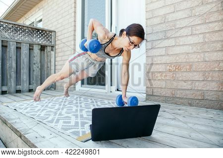 Middle Age Caucasian Woman Doing Push-ups Exercises With Dumb-bells On Home Backyard Online. Video F