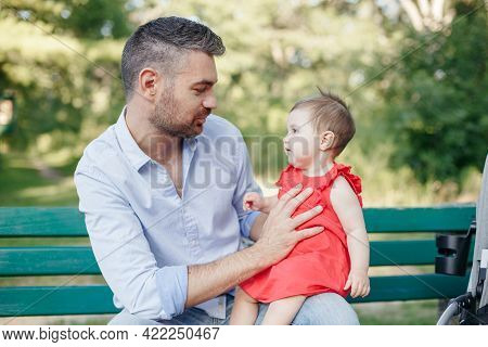 Fathers Day. Middle Age Caucasian Proud Father Talking To Baby Daughter. Family Dad And Daughter Hol