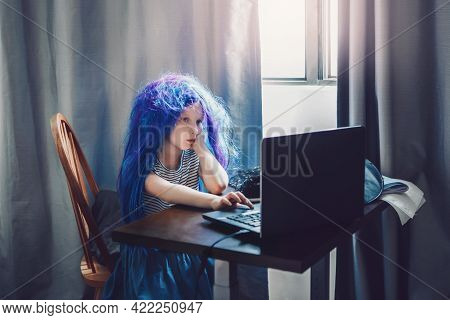 Funny Girl In Blue Wig Learning At Distant Remote Virtual School Online. Homeschooling Class Educati
