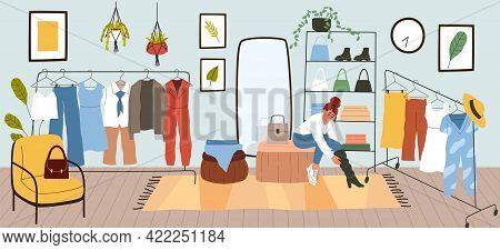 Dressing Room. Woman Puts On Or Tries Clothes. Comfortable Apartment With Rack For Garments And Shel
