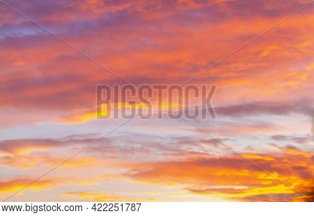 Soft, Airy Sky In The Evening With Feathery Clouds In Orange And Blue Shades.