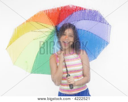 Asian Girl Of Indian Origin With Rainbow Umbrella
