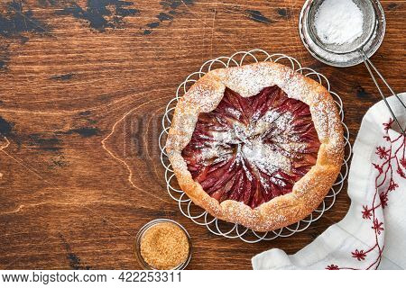 Homemade Rhubarb Galette Made With Star Pattern On Old Wooden Table Background. Process Of Baking. O