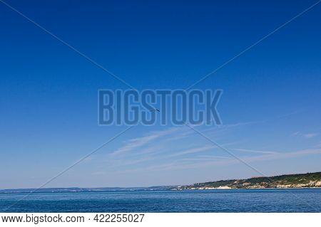 Black Sea Coast. The Coast Of Bulgaria. Sea And Land And Clouds.