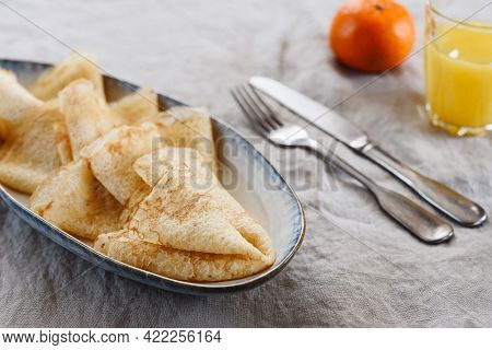 Breakfast With Crepes Or Pancakes And Jam, Juice And Tangerine On Greige Linen Tablecloth. Pancake W