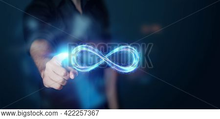 Businessman Showing Infinity Sign, Fire Ice Sign On Gray Background