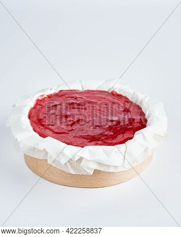 Mini Cheesecake With Red Fruits Jam Topping On Recycle Mini Wooden Baking Mold, White Background, Sp