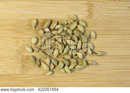 Fresh Tasty Spices, Soft Green Cardamon Top View Close Up On Wooden Bamboo Cutting Board