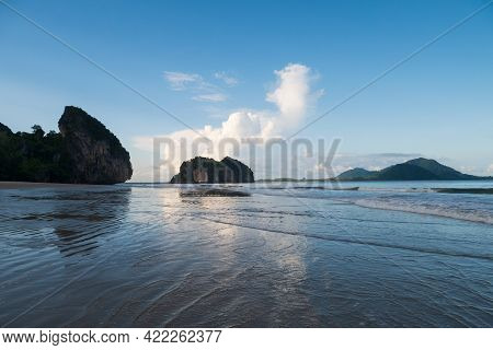 Nature Background Of Seashore Beach Wave And Coastline, Island, Clear Blue Sky With Cloud, And Sunli