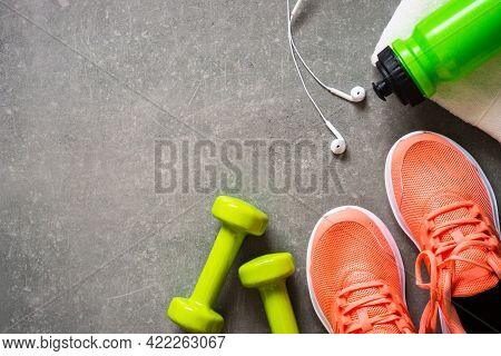 Fitness Equipment At Stone Background Top View.