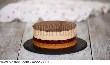 Delicious Homemade Cherry Cake With Caramel Mousse And Sponge Cake Layer.