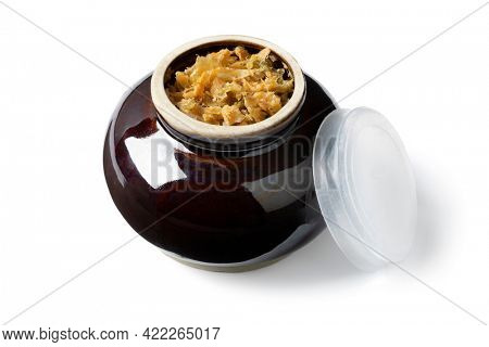 Ceramic bowl with Chinese fermented cabbage isolated on white background