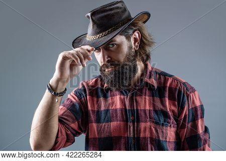 Man Unshaven Cowboys. American Cowboy. Leather Cowboy Hat. Portrait Of Young Man Wearing Cowboy Hat.