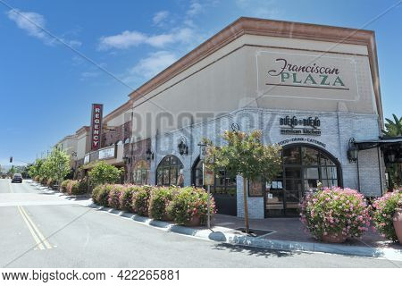 SAN JUAN CAPISTRANO, CALIFORNIA - 27 MAY 2021: Franciscan Plaza and Regency Theater in the Historic Downtown District.