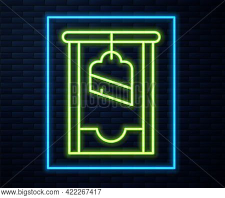 Glowing Neon Line Guillotine Medieval Execution Icon Isolated On Brick Wall Background. Vector