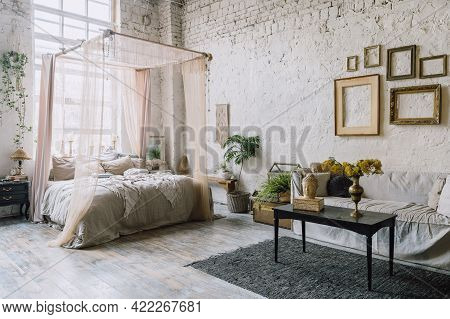 Bed With Baldachin And Huge Window Behind It, Couch And Black Table With Bust Of Buddha And Flower V