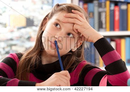Girl Thinking While Doing Homework