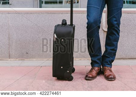Man Carries Luggage In The Lobby Before The Trip. Travel And Vacation Concept. Lifestyle.