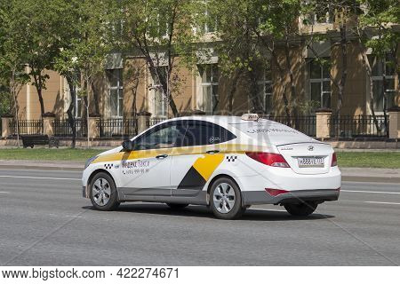 Taxi With Yandex Taxi Logo On The Road. Taxi Cab On The Background Of An Old Building: Moscow, Russi