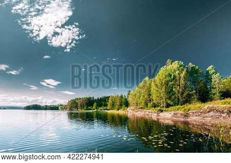 Swedish Nature. Sweden. Summer Lake Or River In Beautiful Summer Sunny Day. Forest Growing On Rocky