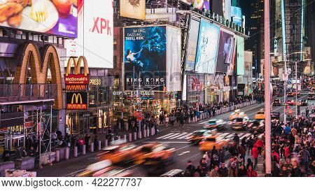 New York City, United States - Apr 4, 2019: Crowd Of People Walking, Car And Taxi Traffic Transporta