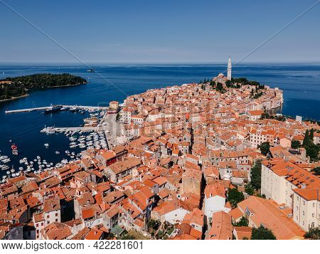 Top View Of The Old Town Of Rovinj, Seaport, Houses With Red Roofs And The Sea, Croatia. The Tiled R