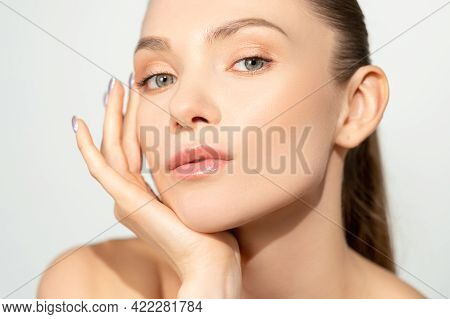 Facial Skincare. Natural Beauty. Freshness Wellbeing. Relaxed Woman With Nude Makeup Touching Radian