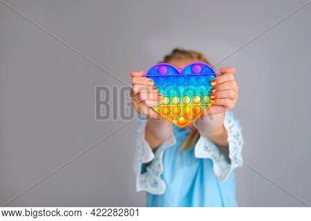 The Child Is Holding A Rainbow Pop It Fidget Toy Instead Of A Head.push Bubble Fidget Sensory Toy -