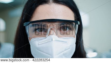 Close Up Shot Of Happy Young Beautiful Caucasian Woman Medical Scientist In Protective Mask And Gogg