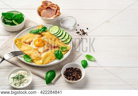 Breakfast With Pancake, Egg And Bacon On A Light Background. Breton Crepe.