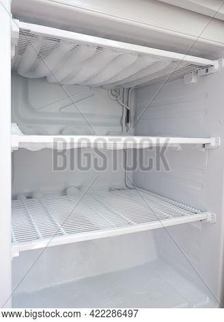 Broken Fridge. Snow On Freezer Shelves. Defrosting The Fridge