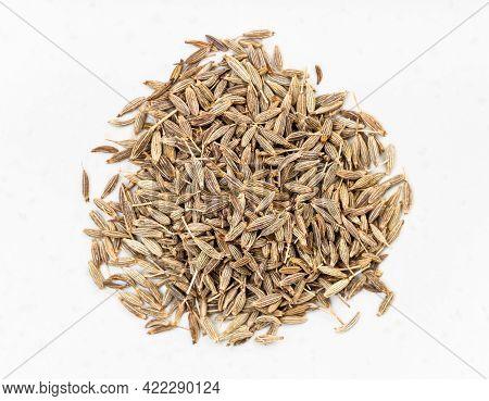 Top View Of Pile Of Cumin (cuminum Cyminum) Seeds Close Up On Gray Ceramic Plate