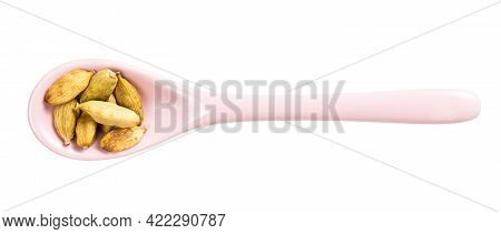 Top View Of Ceramic Spoon With Cardamom Seeds Isolated On White Background