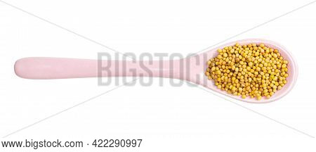 Top View Of Ceramic Spoon With Yellow Seeds Of Brassica Juncea Mustard Isolated On White Background