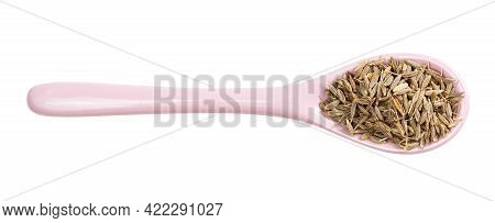 Top View Of Ceramic Spoon With Cumin (cuminum Cyminum) Seeds Isolated On White Background