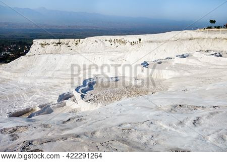Natural Travertine Pools Or Terraces In Pamukkale, Turkey. White Color Of Rocks Caused By Carbonate