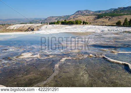 Panorama Of Far Part Of Pamukkale Travertine Park, Turkey. Some Of Terraces Have Natural Color, Some