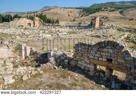 Ruins Of Ancient Nymphaenum Of Tritons In Antique City Hierapolis, Pamukkale, Turkey. Remains Of Mon