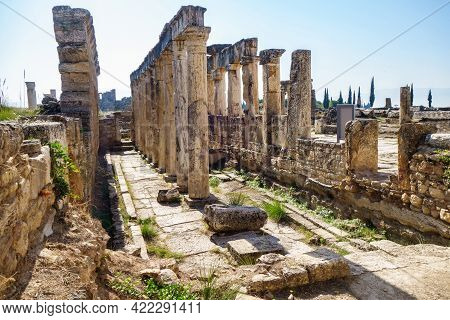 Panorama Of Antique Latrine In Ancient City Hierapolis, Pamukkale, Turkey. There Are Columns & Remai